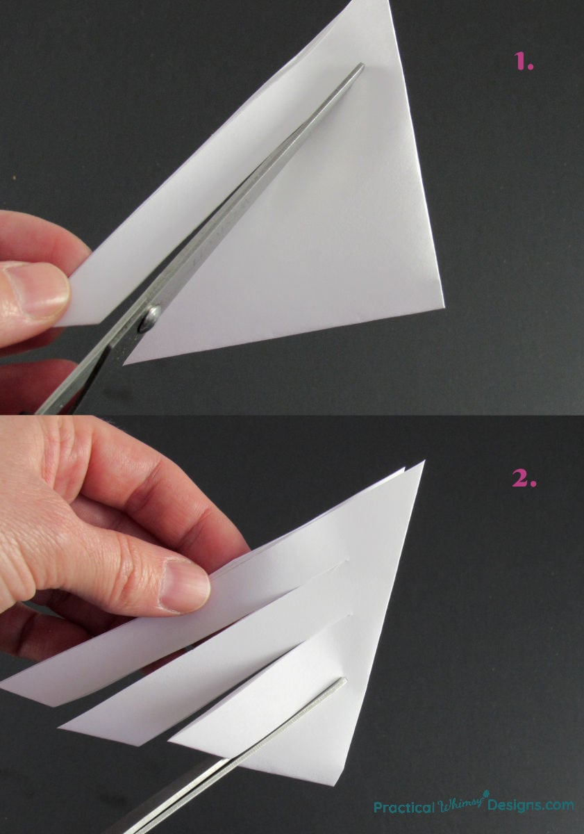 Cutting strips in a folded paper triangle