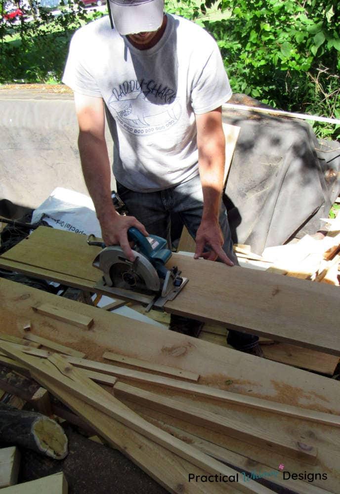 Cutting trellis boards with circular saw.