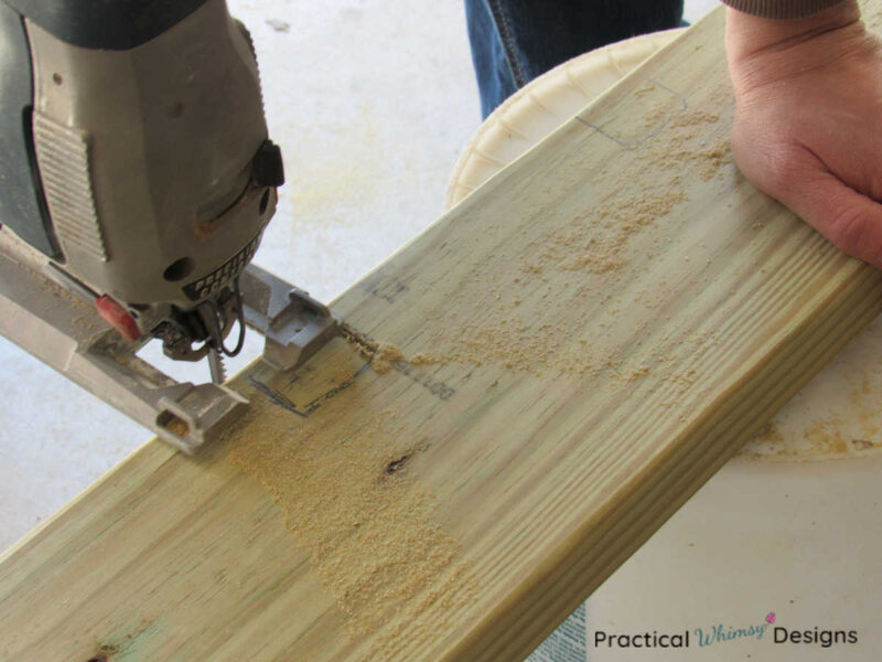 Cutting out notch in rafter with a jigsaw.