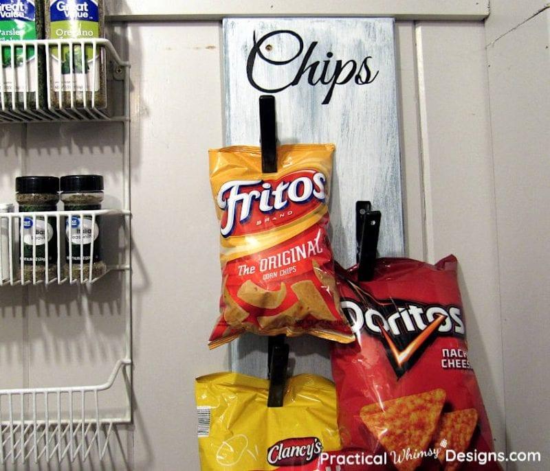 Chips hanging on DIY chip storage rack in pantry