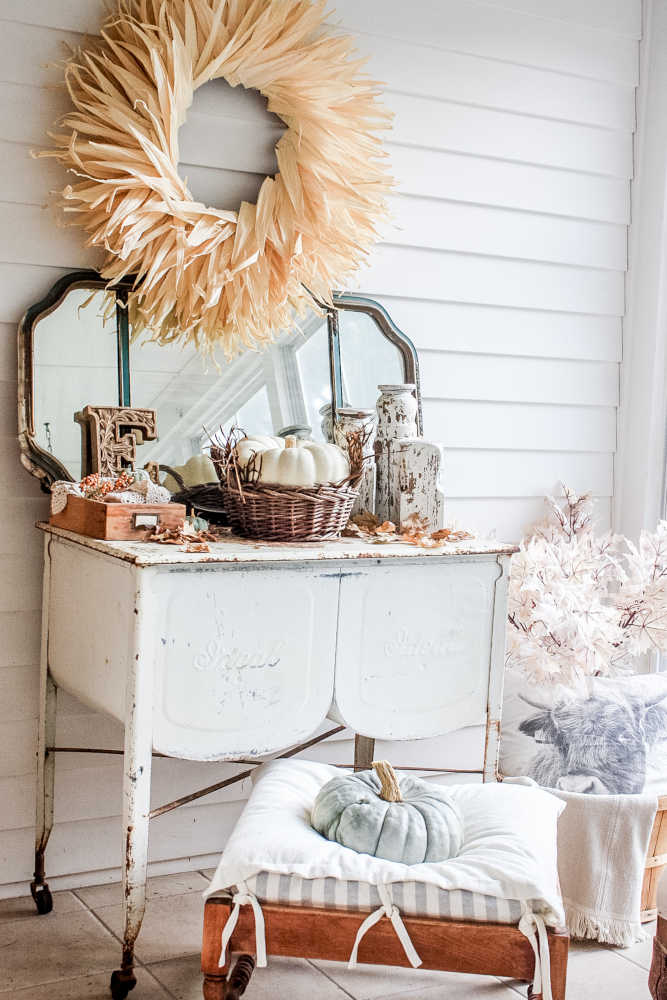 DIY corn husk wreath over a cabinet