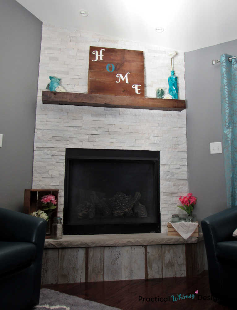 Wooden home sign on mantel in family room