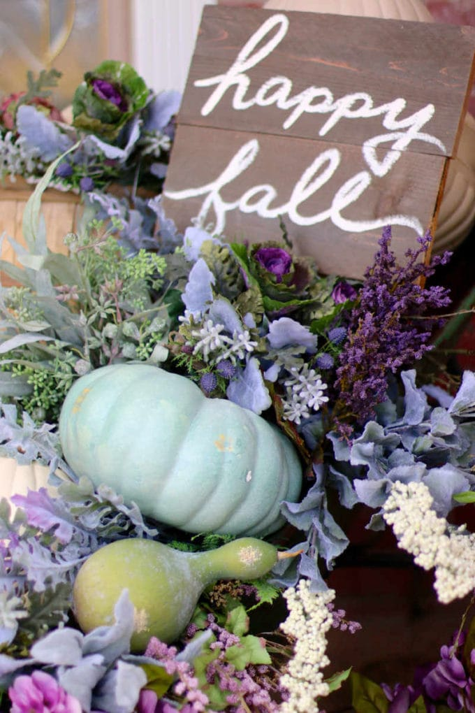 Happy fall sign with flowers and pumpkins