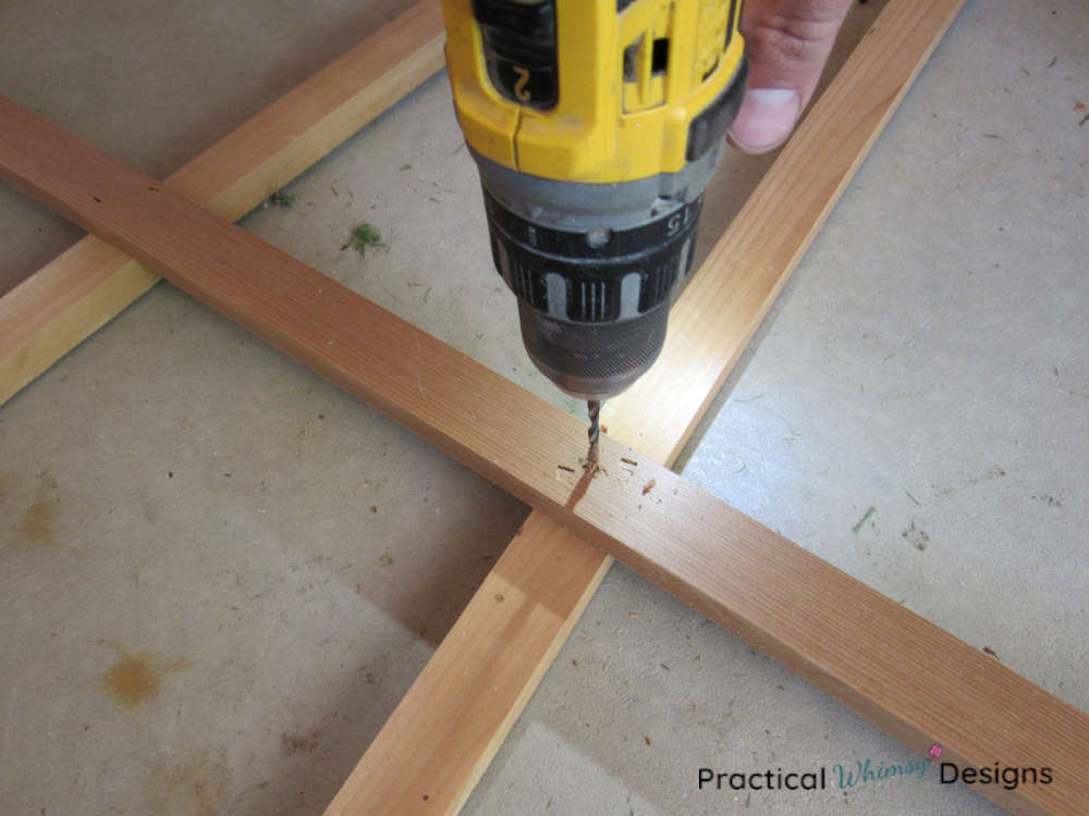 Drilling holes with drill bit for screws.