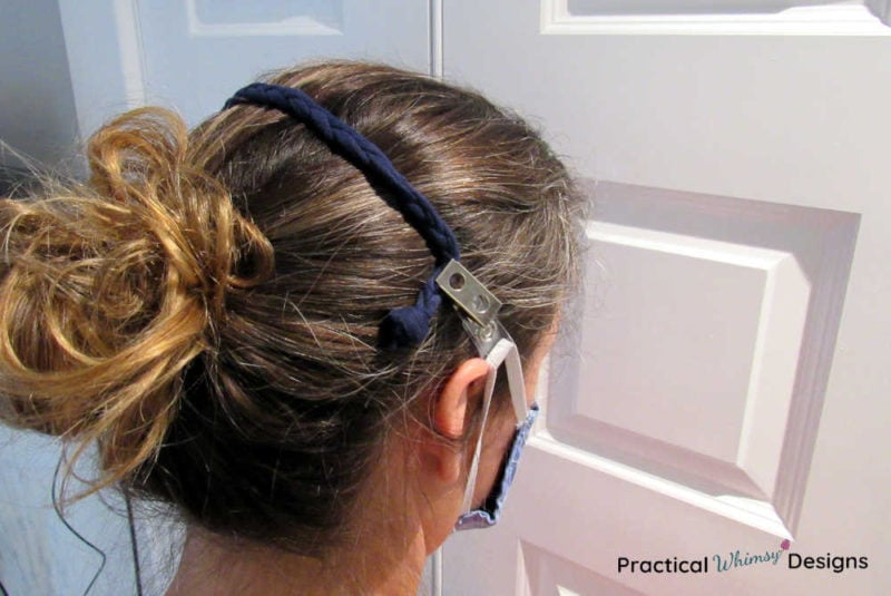 DIY ear saver stretched across back of head.