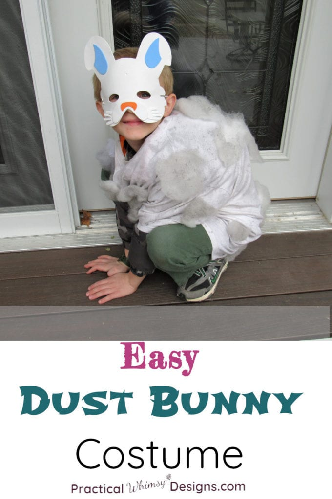 Easy Dust Bunny costume. Boy wearing bunny mask and dust bunny costume crouched on step.