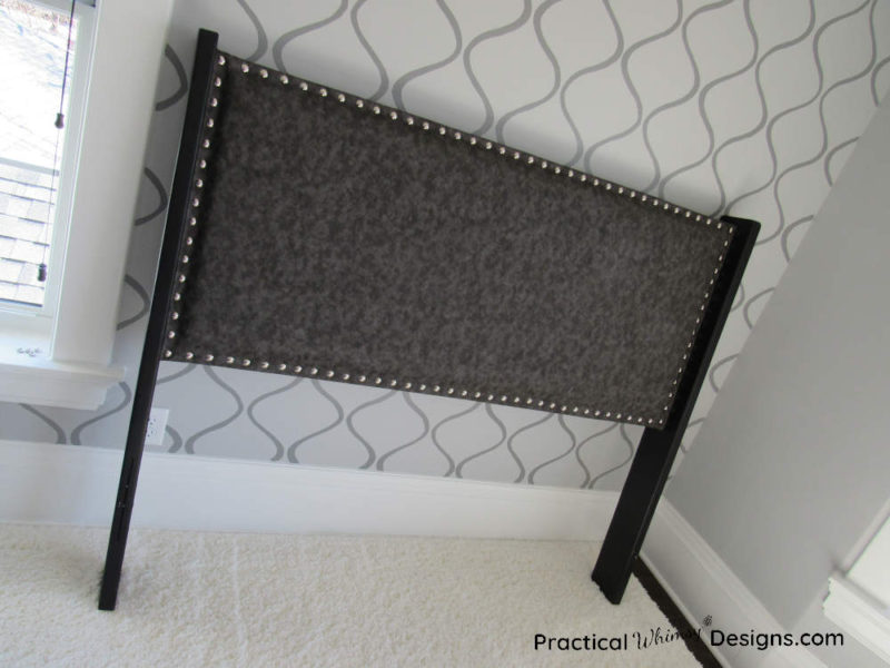 Finished DIY fabric headboard with upholstery tacks