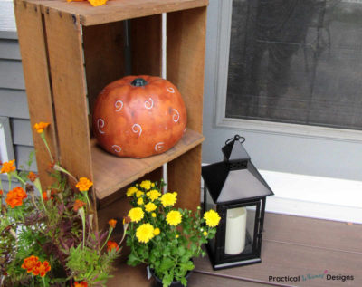 Fall decor and flowers on small porch