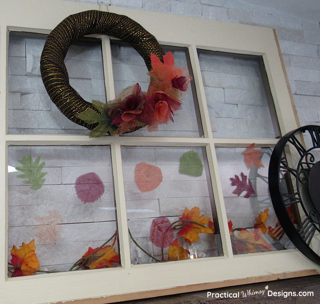 Fall wreath and leaves on window