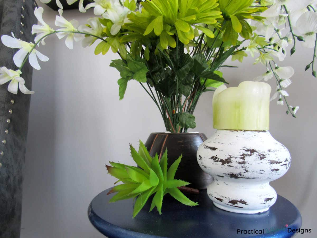 Upcycled Farmhouse candlestick with vase of white and green flowers