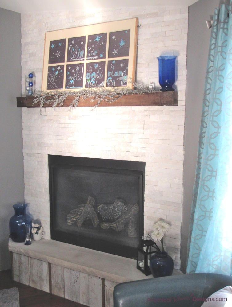 faux chalkboard window above the fireplace