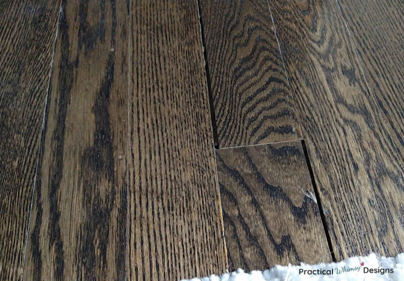 Stained hardwood flooring with gaps between each board