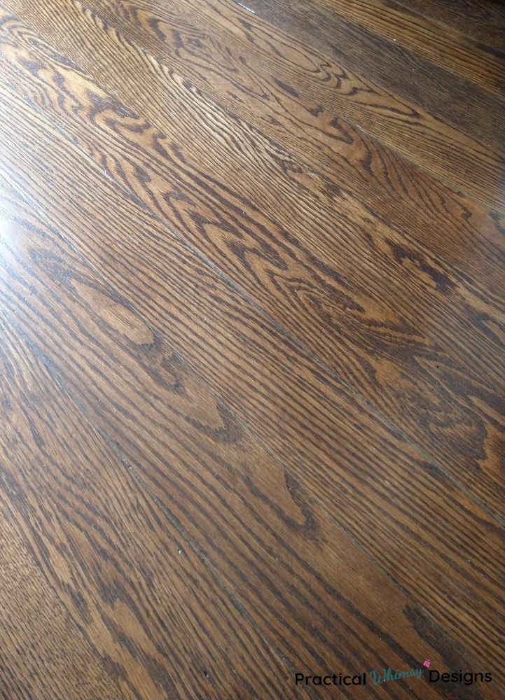 Flooring with stained wood filler in gaps.