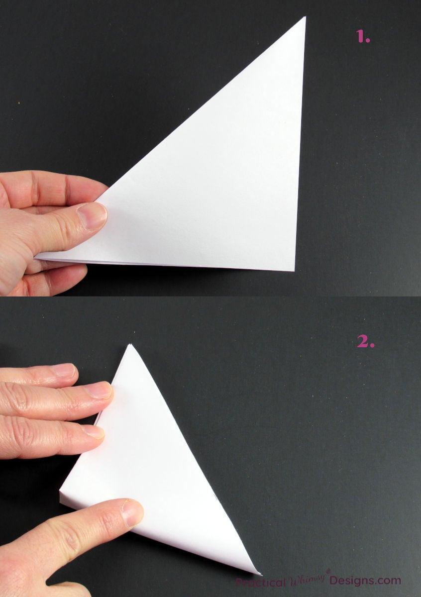 Folding a paper square into a triangle