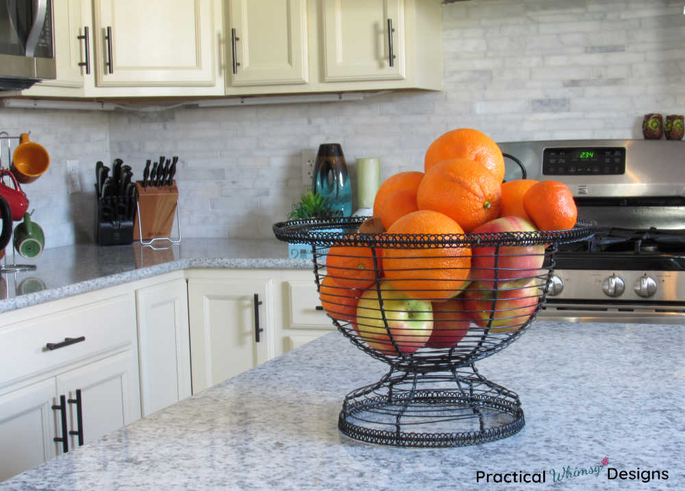 Bowl of oranges and apples on counter in new kitchen