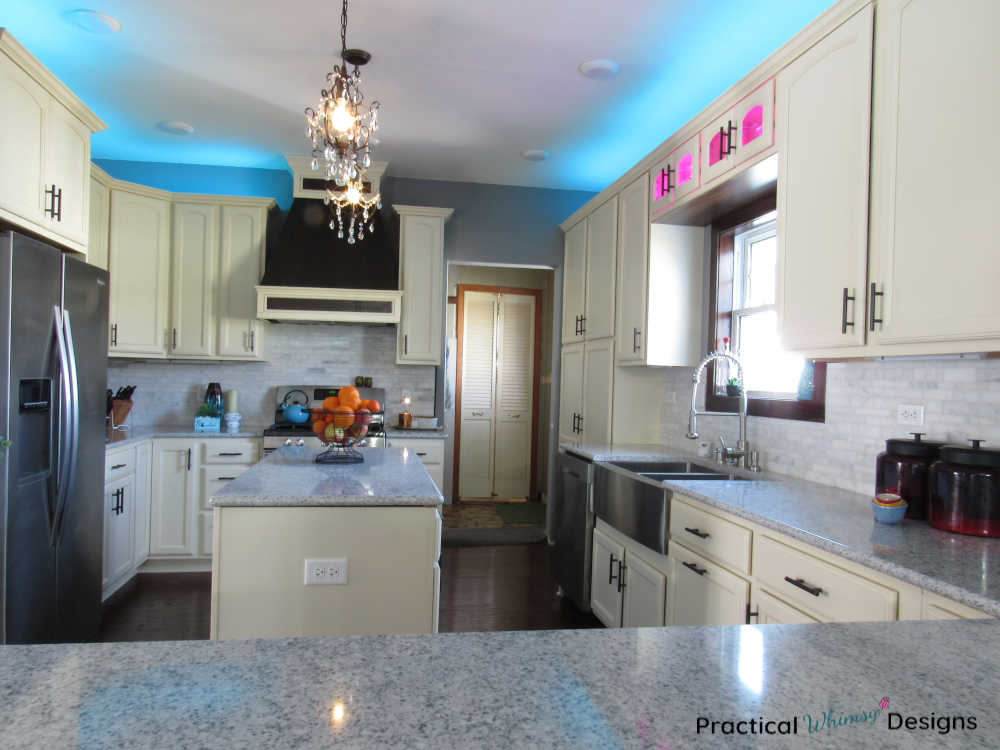Full kitchen reveal with white cabinets and quartz counters