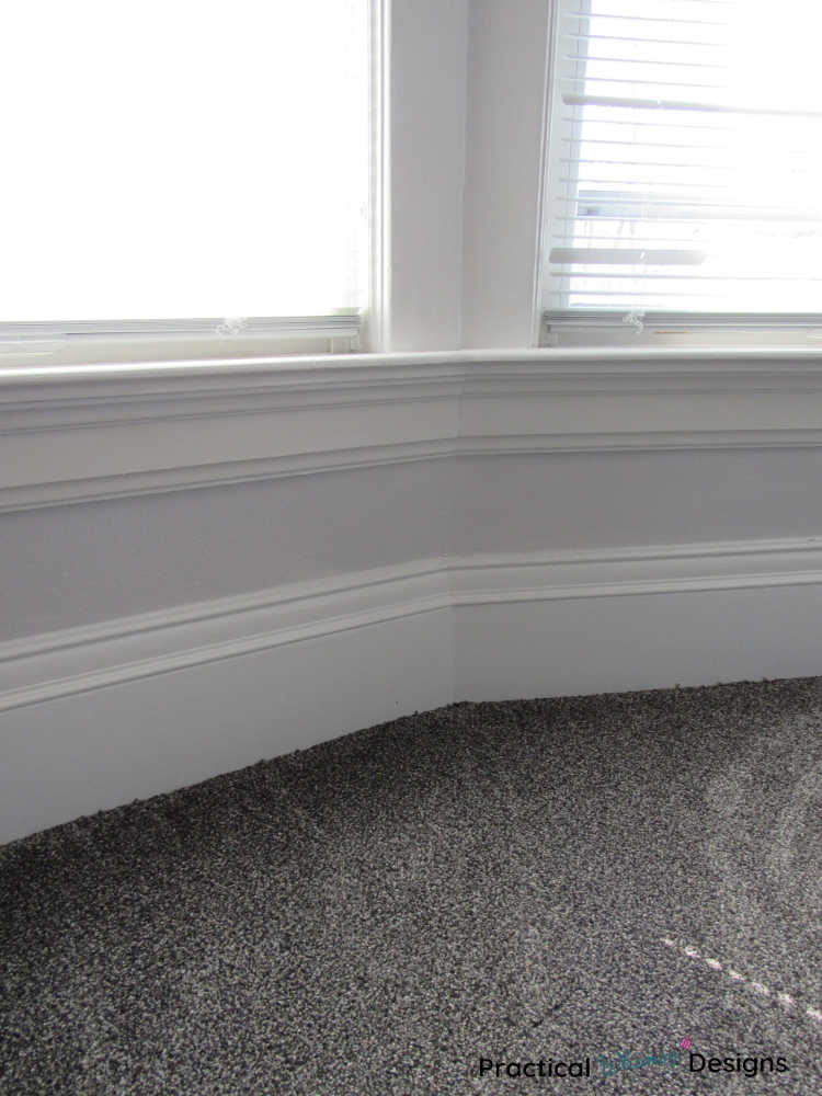 Grey carpet next to windows