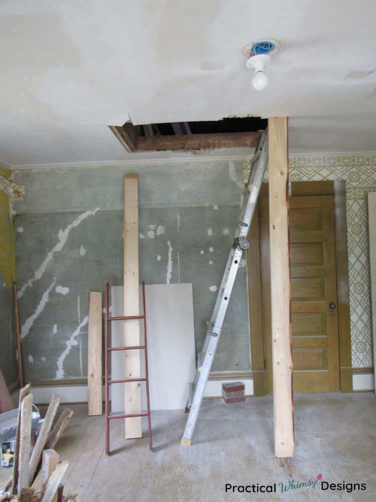 Hole in bedroom ceiling with ladder leaning against it.