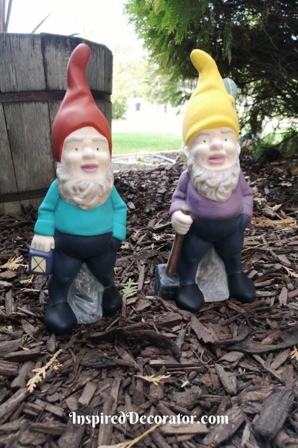 Garden gnomes on wood chips