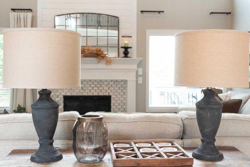Two DIY rustic lamps in living room