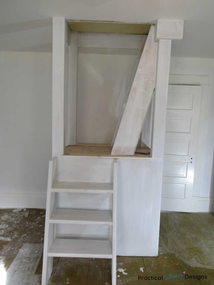 Built in ladder platform primed white