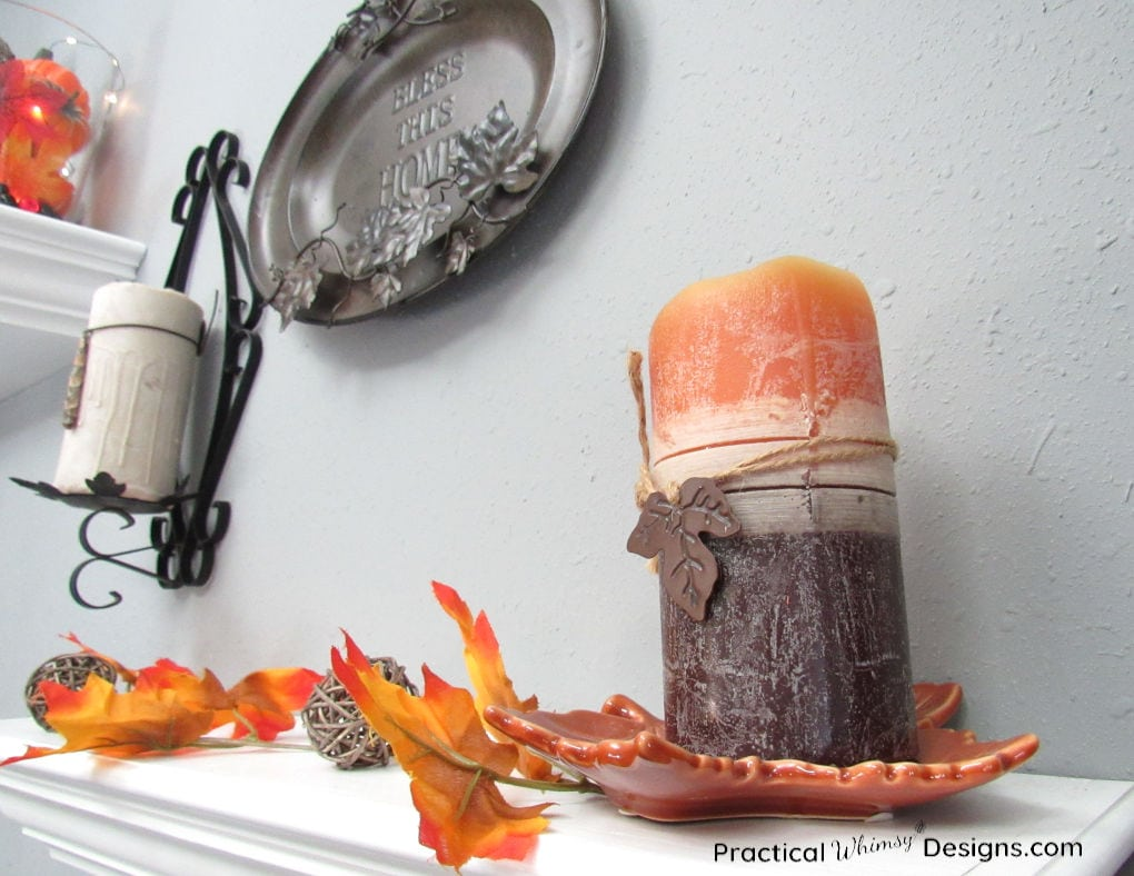 Leaf vines and candles on a shelf for easy indoor fall decorations