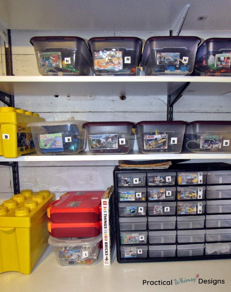 Legos in shoeboxes on a shelf