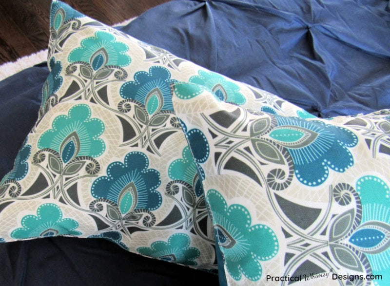 How to make pillows out of placemats: pillows on bed.