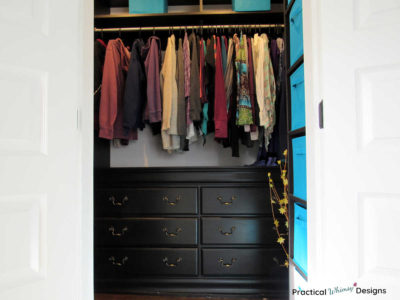 Master closet reveal with hanging clothes and built in dresser