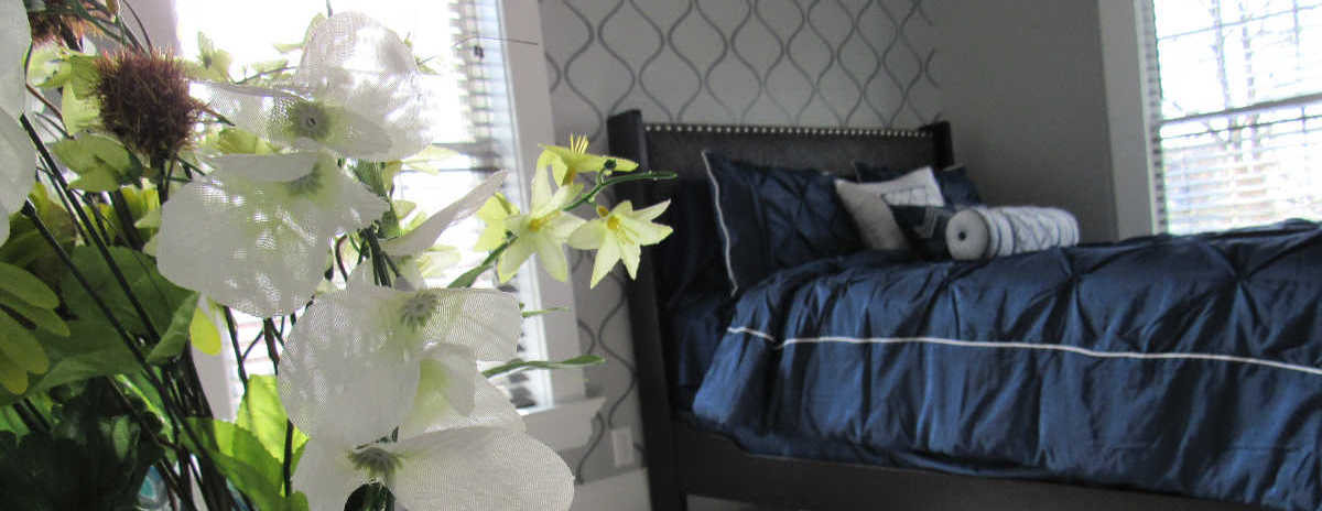 Master bedroom with gray stenciled walls and blue bed: DIY and Home Decor inspiration