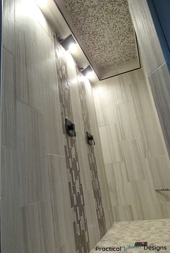 Master shower with cleaned and sealed grout lines.