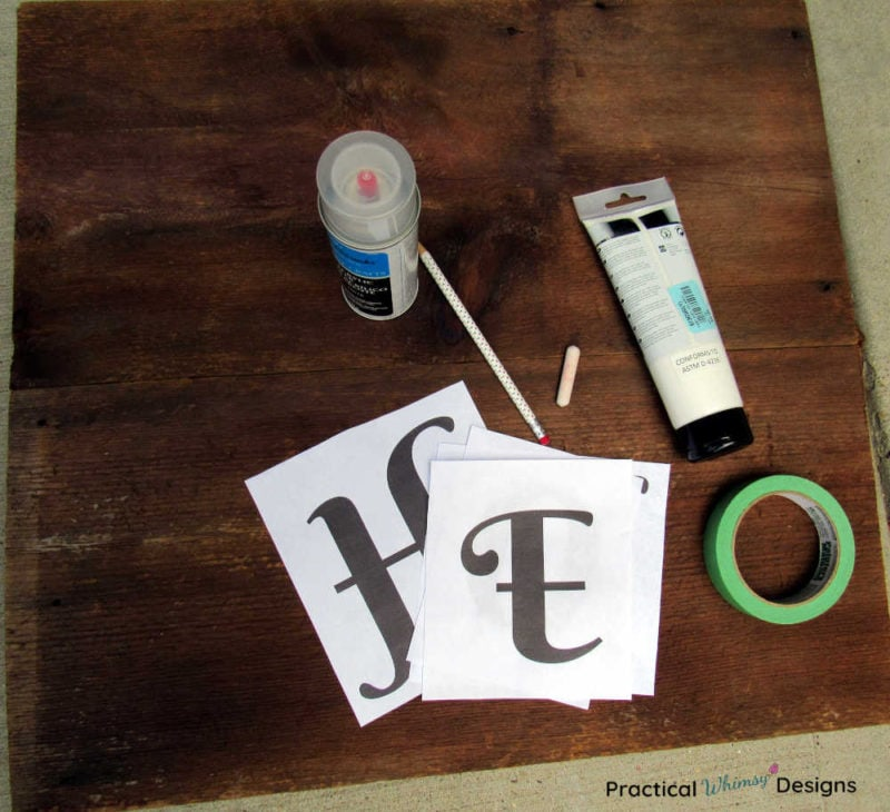 Materials to paint wooden sign: letters tape, paint, chalk, pencil, and acrylic sealer.