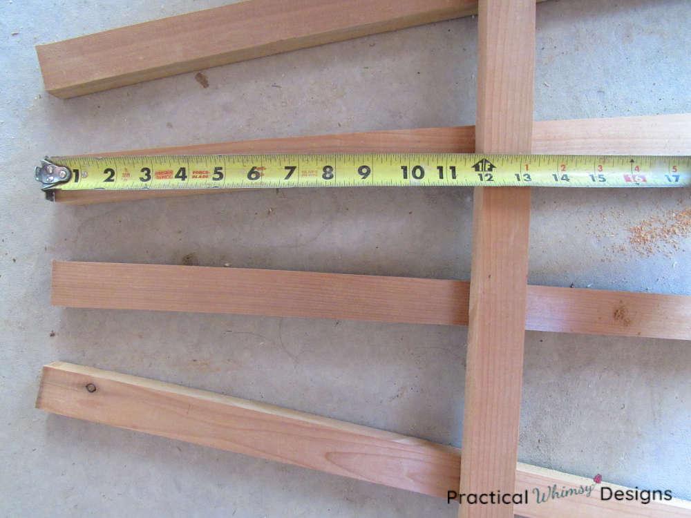 Measuring bottom of trellis.