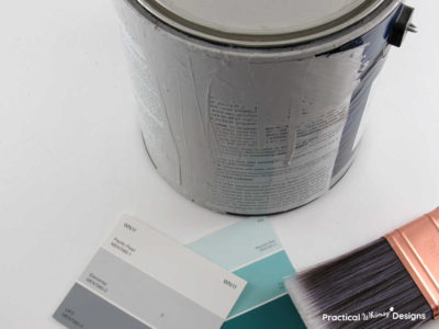 Paint brush and paint can with color swatches
