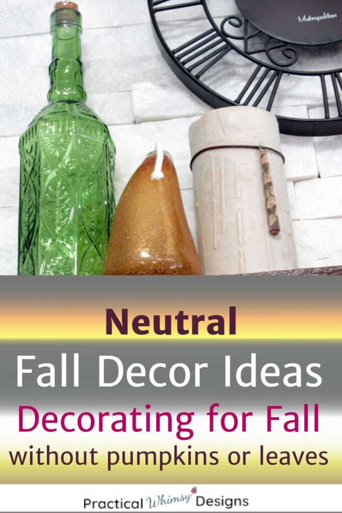 Neutral fall decor of vases and candles on shelf.