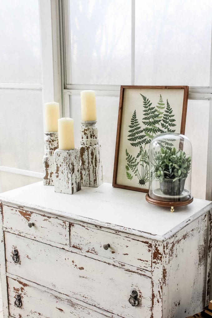Candlesticks sitting on white dresser