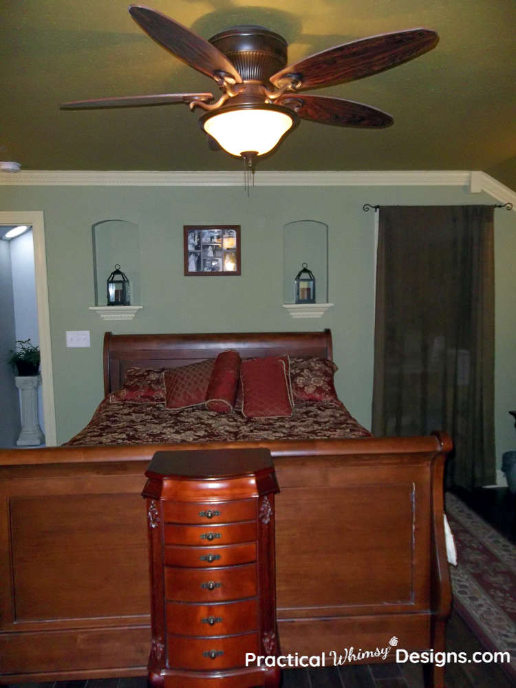 Queen sleigh bed in master bedroom.