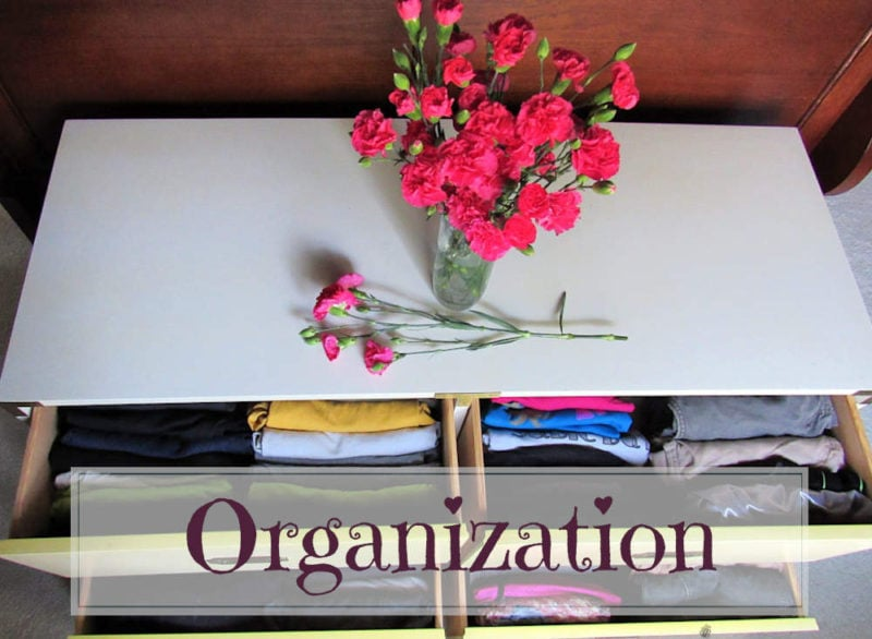 Organization: Clothes in drawer with flowers on top