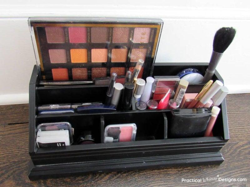 Makeup organized in an office organizer.