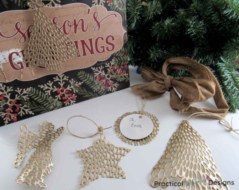 Gold ornament gift tags made out of placemats.