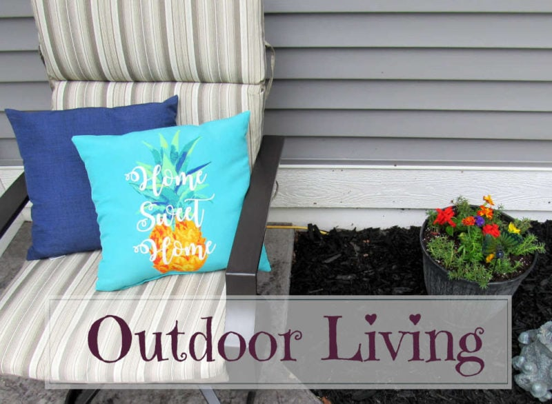 Outdoor Living: Patio chair with pillows next to a pot of flowers