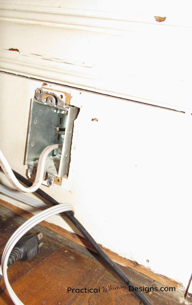 Outlet box cut into base trim.