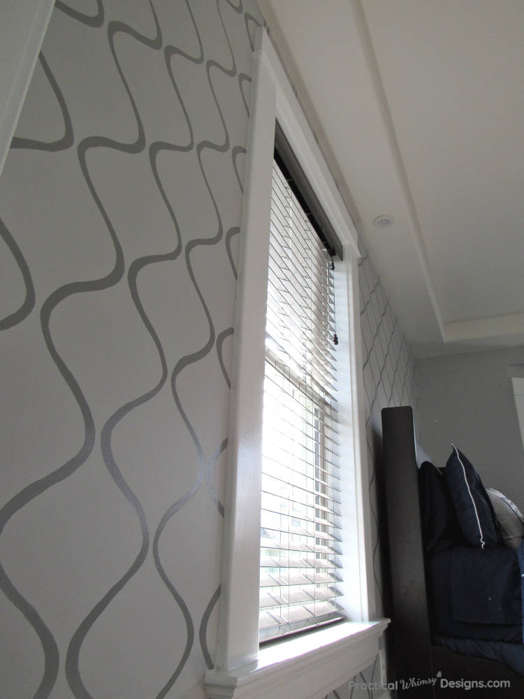 Stenciled accent wall in master bedroom.