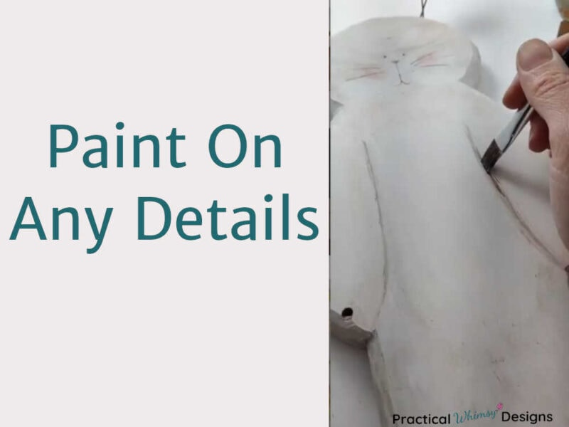 Painting details on wooden decor with acrylic paint