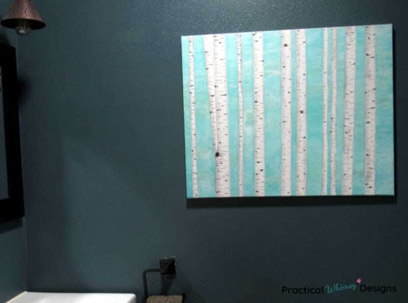 Blue birch tree painting on wall in bathroom
