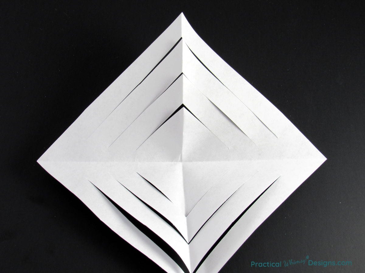 Paper square with triangle slits cut in it