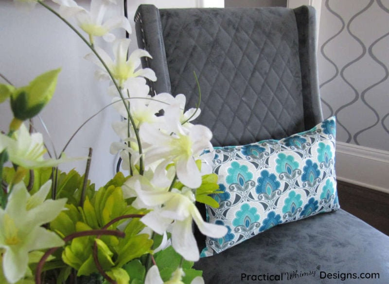 Pillow on chair in master bedroom.