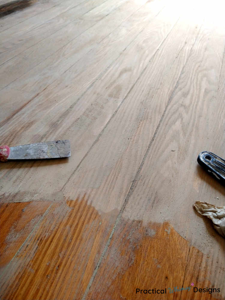 Hardwood flooring with wood filler spread on it.