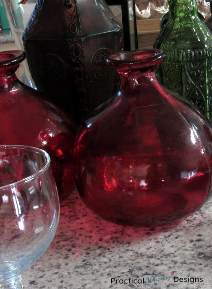 Red, green, and brown vases