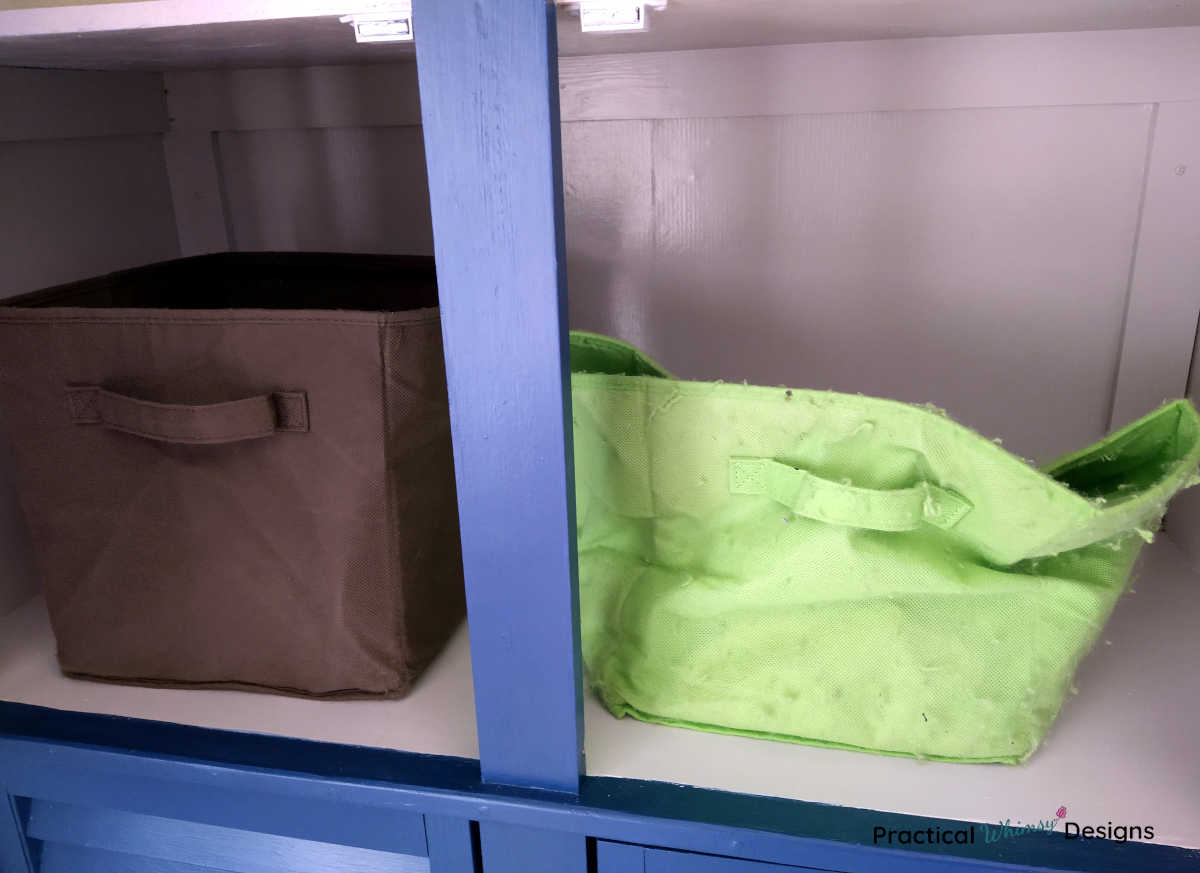Fabric boxes on shelf.